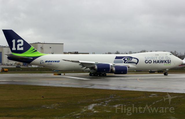 BOEING 747-8 (N770BA) - Boeing shows off Seattle Seahawks Superbowl run pride by painting N770BA in team colors.This is the first time it took to the air after being painted.