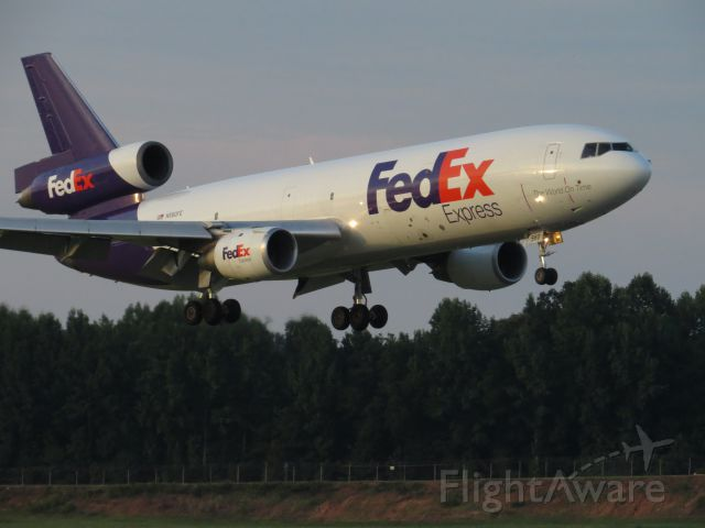 McDonnell Douglas DC-10 (N560FE) - Taken from airport overlook July 17, 2014. Arriving on 18c