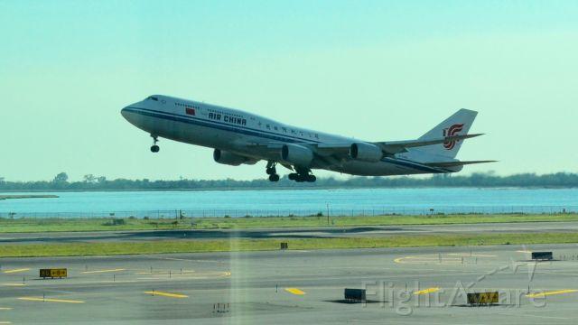 — — - Air China taking off (JFK NYC)