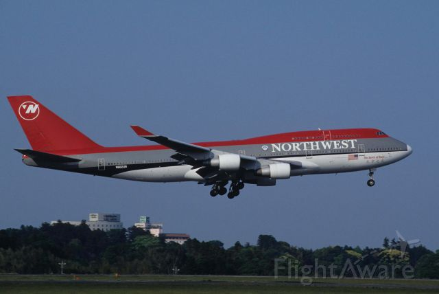 "Boeing 747-400 (N662US) - Short Final at Narita Intl Airport Rwy16R on 1996/05/25 "" Spirit of Beijin """