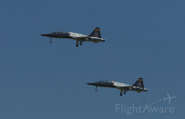 — — - a pair of USAF T38 Talons make a low altitude flyover at KJAN.
