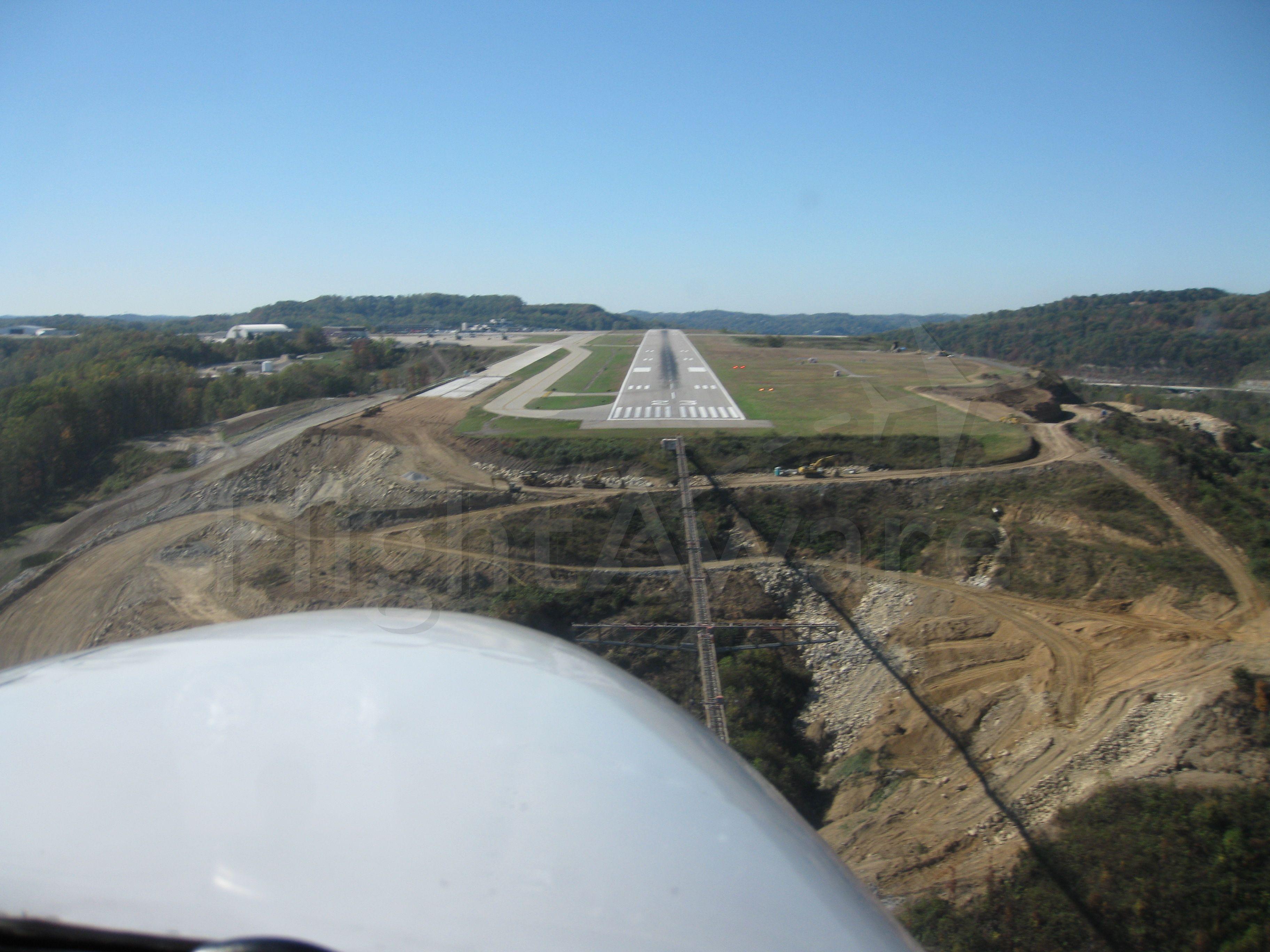 Cessna 310 (C-GKAS) - Short final...23