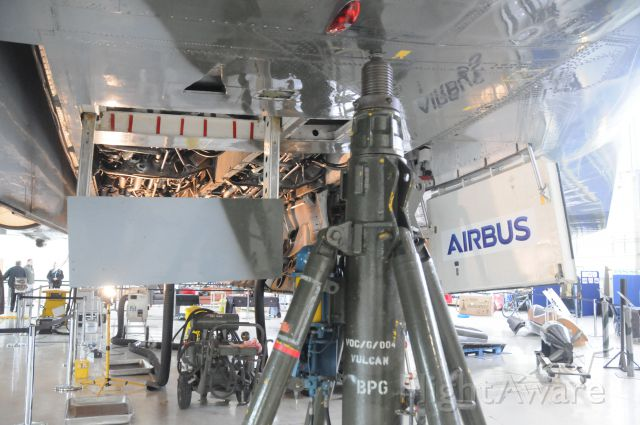 G-VLCN — - Lifting Jacks being placed in preparation for lifting the Vulcan off the floor to test the Main Under Carriage operation. This is Port front, one of 4 jacks used.to the left is the under wing Airbrake.