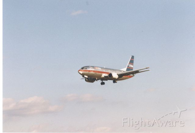 Boeing 737-700 — - USAir Boeing 737 approaching runway 33L at KBWI, late 1996