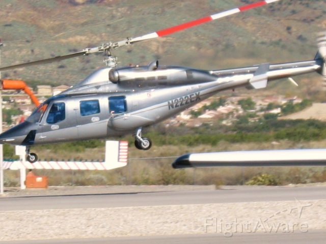 Bell 222 (N222EX) - Lifting off from Redlands Muni
