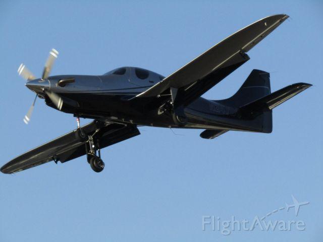 Lancair Evolution (N247DC) - Landing RWY 24