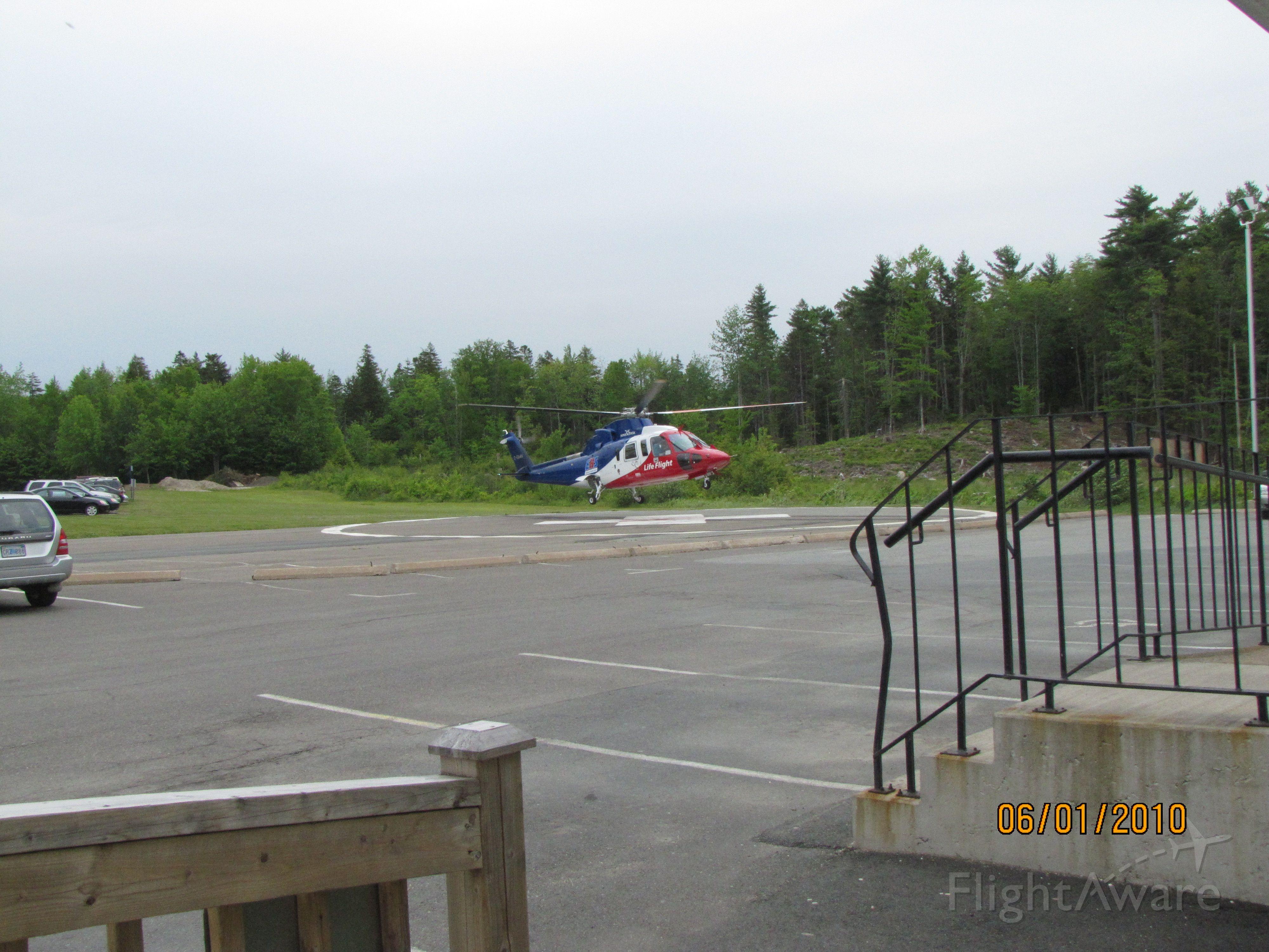 C-GIMN — - Lifting off the Helipad at the Bridgewater Hospital.    June 1/2010