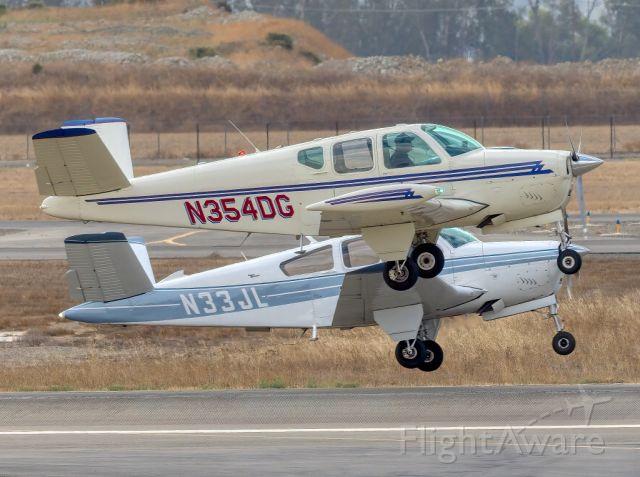 Beechcraft 35 Bonanza (N354DG) - Beech Beechcraft J35 (foreground) and V35A at Livermore Municipal Airport, Livermore CA. October 2020