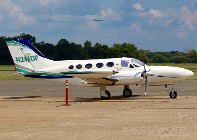 Cessna 421 (N214DF) - At Downtown Shreveport. Even get a B-52 in the background on final for runway 15 at Barksdale AFB.