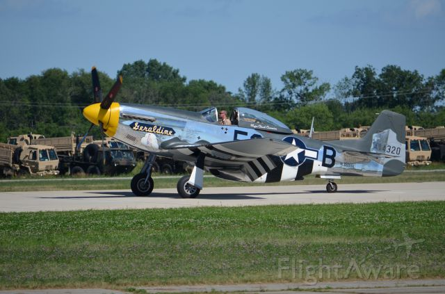 """North American P-51 Mustang — - EAA 2011 P-51D """"Geraldine"""" taxiing back to warbirds area."""