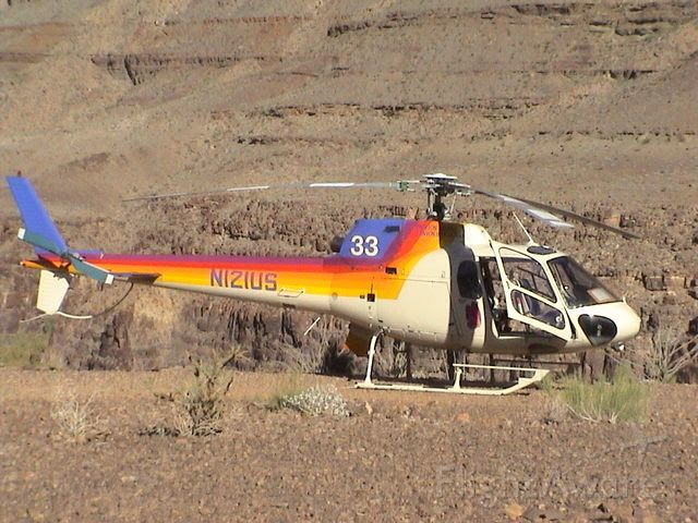 Eurocopter AS-350 AStar (N121US) - Standing in the Grand Canyon during lunch break on a tour in 2003.