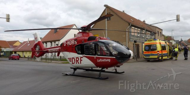 Eurocopter EC-635 (D-HDRS) - EC- H135 rescue helicopter( Christoph 60 )town center intersection in D-Wechmar  ( DRF )