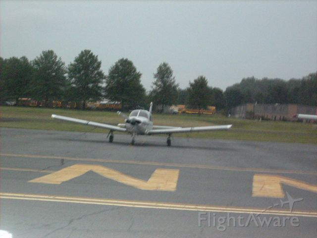 Piper Cherokee — - A blurry picture of a rental plane sitting on the ramp at the Doylestown Airport in Pennsylvania. This picture was taken at night.