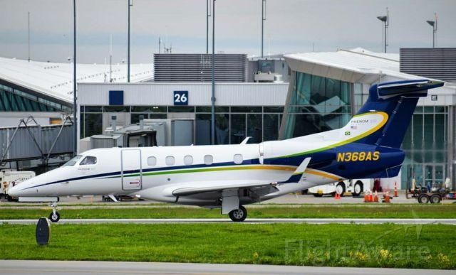 Embraer Phenom 300 (N368AS) - Photo Taken May 2019