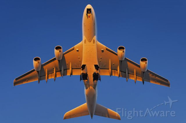 Airbus A380-800 (F-HPJC) - The intense glow of the setting sun paints an Air France operated Airbus A380-861 super jumbo golden, as it takes to the skies after departure from the Los Angeles International Airport, LAX, in Westchester, Los Angeles, California