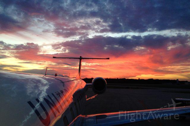 Embraer ERJ-145 — - A beautiful sunset illuminates the sky behind my final flight of the evening at KCHS / photo taken with an iPhone6s