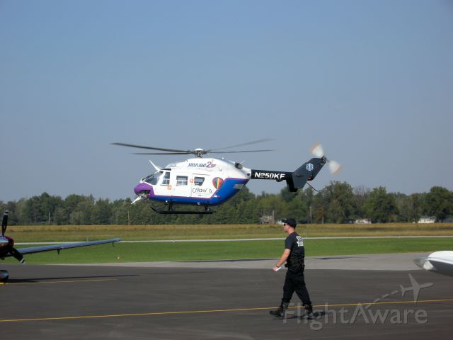 N250KF — - St Louis children's hospital kidsflight departs KPOF as a Missouri state trooper crosses the tarmac headed for an awaiting highway patrol helicopter.