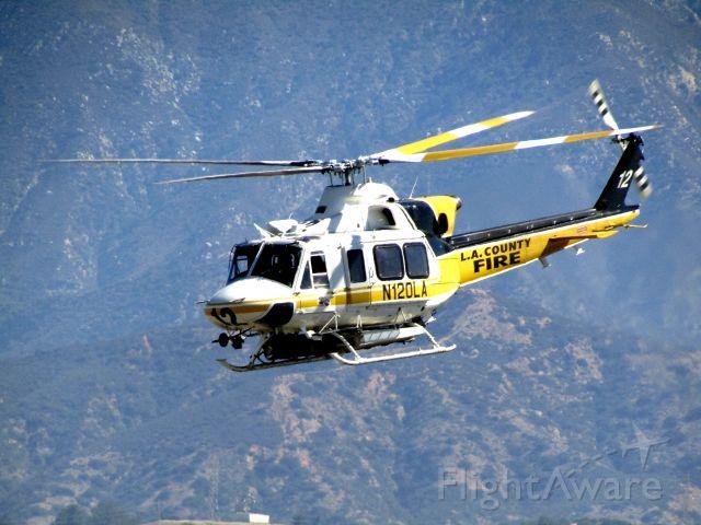 Bell 412 (N120LA) - Lifting off RWY 26R