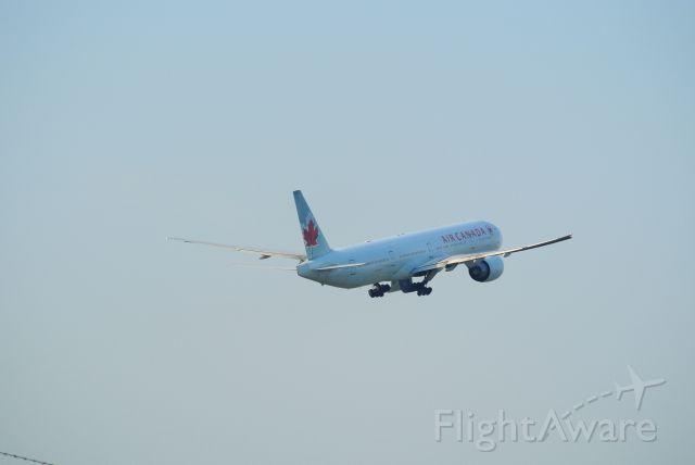 BOEING 777-300ER (C-FIUL) - Gear up, 777-300ER off of 23