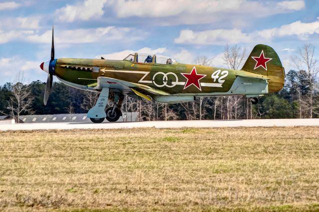 Experimental 100kts-200kts (N1157H) - A Yak-9U touches down at the Auburn, Alabama airport.