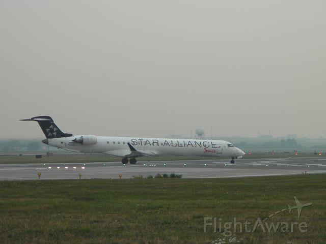 Canadair Regional Jet CRJ-700 (C-FUJZ) - Takeoff from Runway 23