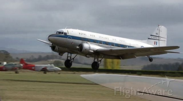 Douglas DC-3 (ZK-DAK) - Landing at Classic Fighters 2015.<br>This from NZ Civil Aircraft Blog:<br>Douglas DC-3C S1C3G ZK-DAK c/n 26480/15035 very cunningly disguised as NZ3546. This aircraft actually has no real Royal New Zealand Air Force connections at all.<br>It began life as a C47B-10-DK with the USAAF serial of 43-49219 from 30th October of 1944. After its ten years of service its tail number was changed to O-49219 (as is the custom). After service at various bases in the USA and Bermuda it went to Japan in July of 1950 and served with the 21st Troop Carrying Squadron based at Ashiya, covering the Korean War period.
