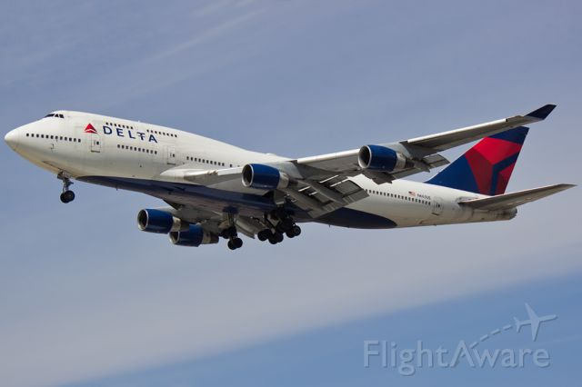 Boeing 747-400 (N663US) - Delta 99 arriving on 21L from Paris.  04/12/2015.