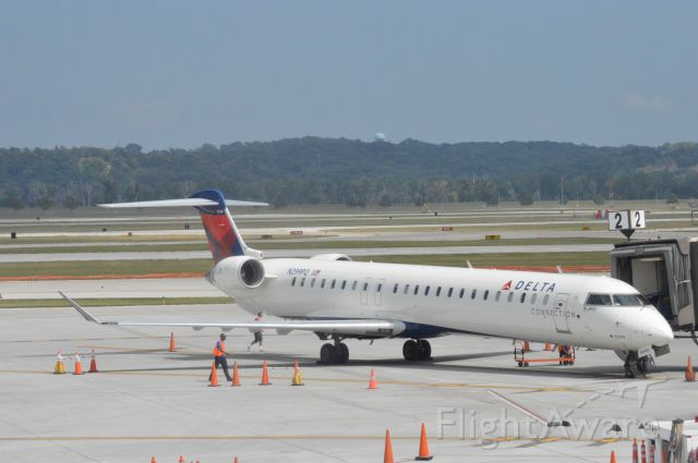 Canadair Regional Jet CRJ-900 (N299PQ) - 2 hours and 17 minutes late, Delta Connection (Flagship) 381 arriving from Detroit at 3:07 PM CDT.   Taken August 11, 2016 at OMA with Nikon D3200 mounting 55-200mm lens.