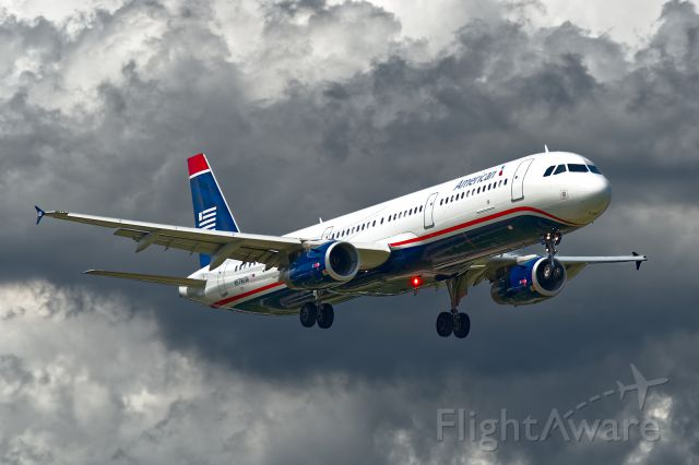 Airbus A321 (N578UW) - Old and New. On short final to 19R just after getting pressure washed about 10-miles back...