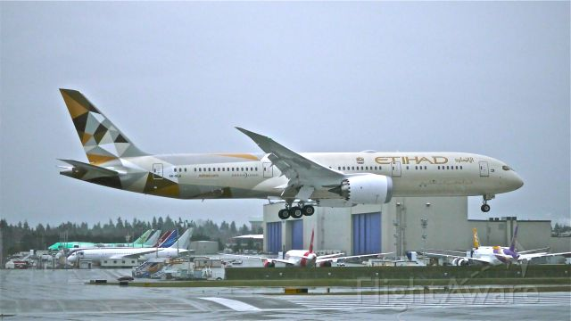 Boeing 787-9 Dreamliner (A6-BLA) - In a heavy rain storm and failing light BOE77 returns to Rwy 16R from its maiden flight on 12/8/14. (ln 229 / cn 39646).