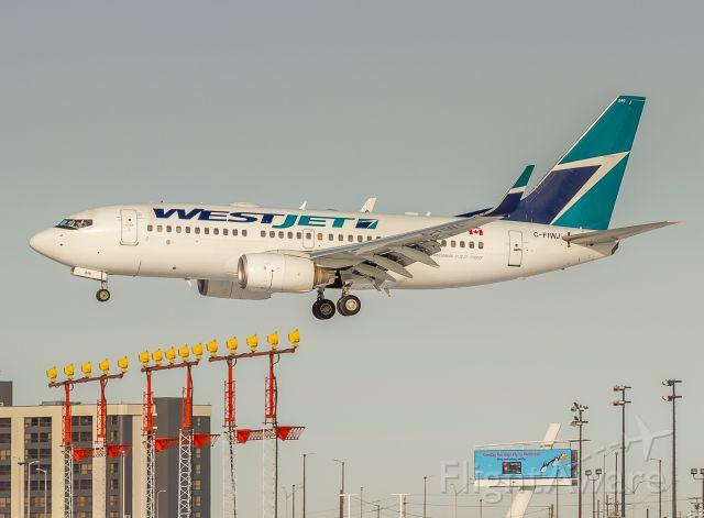 Boeing 737-700 (C-FIWJ) - Westjet 156 arrives from Regina, very short finals for runway 24R