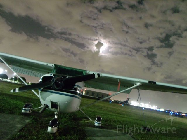 Cessna Skyhawk (N96100) - A full moon hides behind the clouds, yet still illuminates the night. br /br /[Image © Learn To Pilot .COM™]