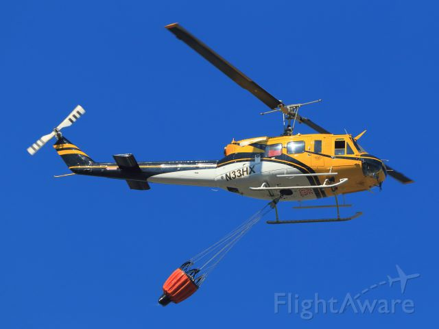 Bell UH-1V Iroquois (N33HX) - BELL 205A-1(Military UH-1 Iroquois), with 320+ Gal/Bucket, Over June Lake Fire 9-17-14