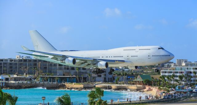Boeing 747-400 (EC-MQK) - Wamos air flying for Air France over maho beach area and landing at TNCM St Maarten.