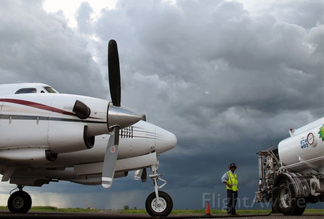 Beechcraft King Air 90 (ZS-OAE) - Refuelling at Quelimane, Mozambique. You wanna get going as a thunderstorm is approaching.