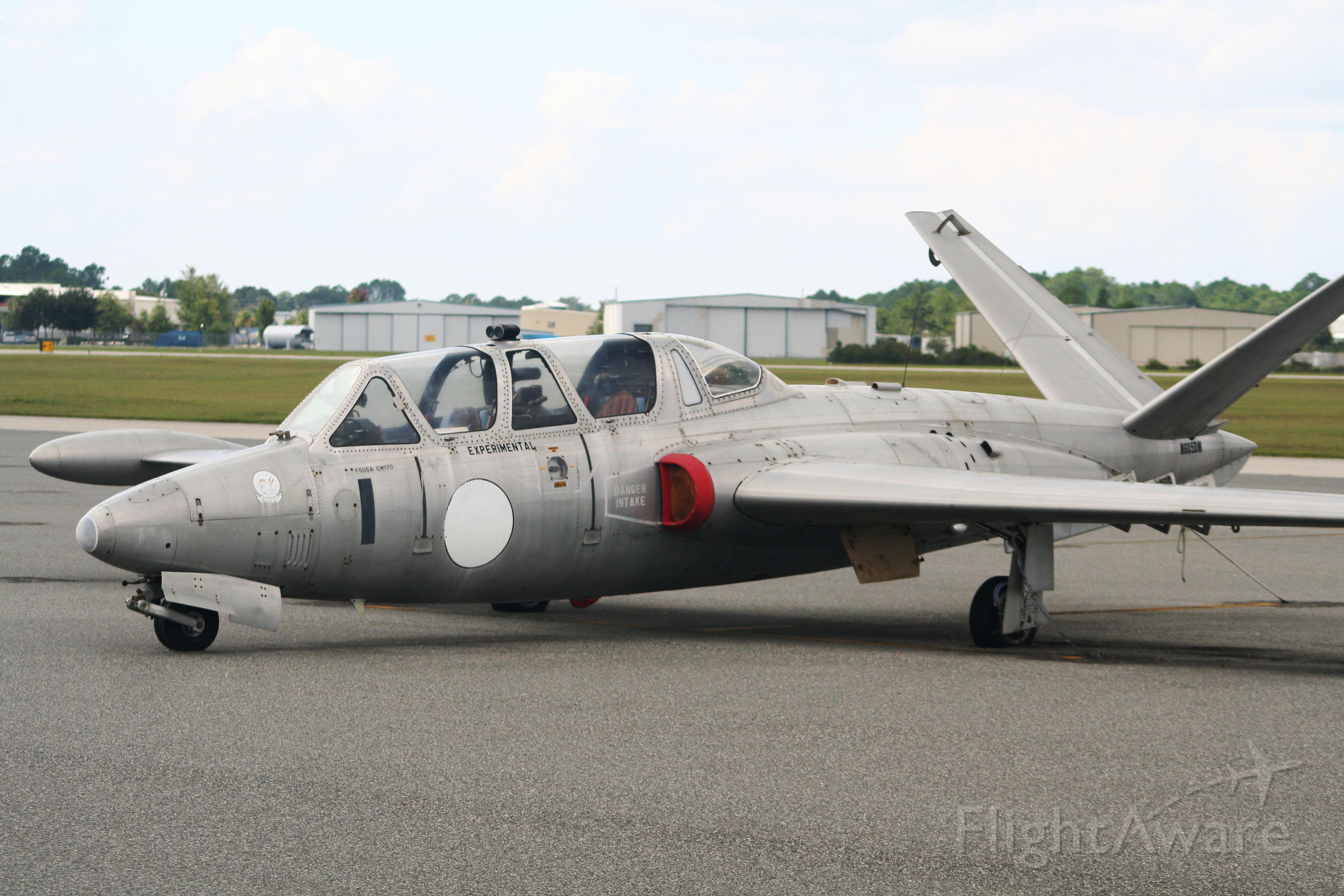 """N6050N — - Fouga CM170 parked on the deck at Deland Florida.  Doesnt look like it has been moved in years but it is still cool to look at!  Flightaware calls it a Valmet Magister but this one has a tag on it that states that it is a Fouga CM170.  Designed in 1948 as a French Jet Trainer it was later exported to Germany, Israel, Finland, Belgium, Katanga, Ireland and Brazil.  Take a look at Wikipedia under """"Fouga Magister"""", this is a very interesting aircraft."""