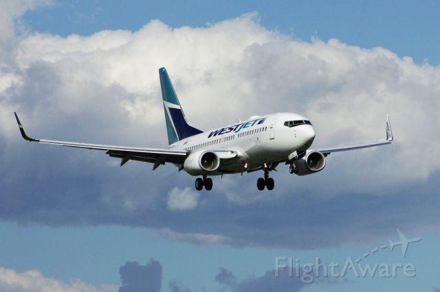 Boeing 737-700 (C-FUWS) - 1/4000 shows turbofan action. Slight wobble from gusty headwind runway 25. 2010:08:17. 17:25