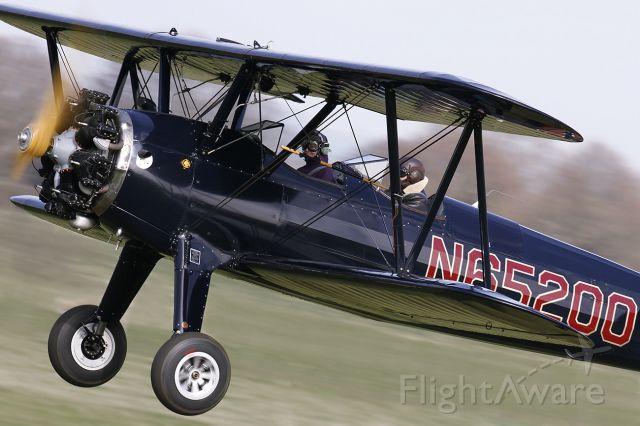 Cessna Skyhawk (N65200) - [cn.75-3817]. Boeing PT-27 Kaydet [D75N1] N65200 leaving the grass strip at Lashenden EGKH Headcorn Kent England 10.3.2012.
