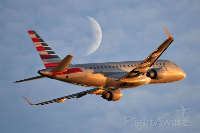Embraer 175 (N109HQ) - American Eagle on 11-19-20 departing 23-L. She is being followed by a moon shadow.