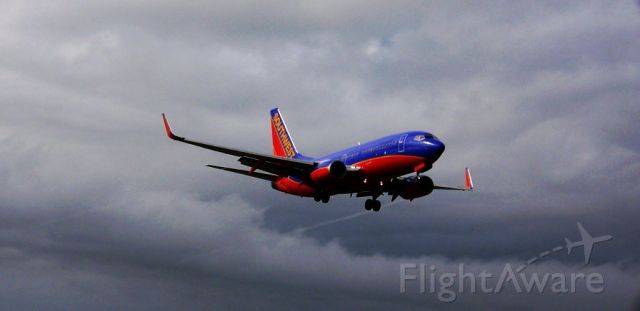 Boeing 737-700 — - Arrives at 12R dodging the rain and heavy weather.