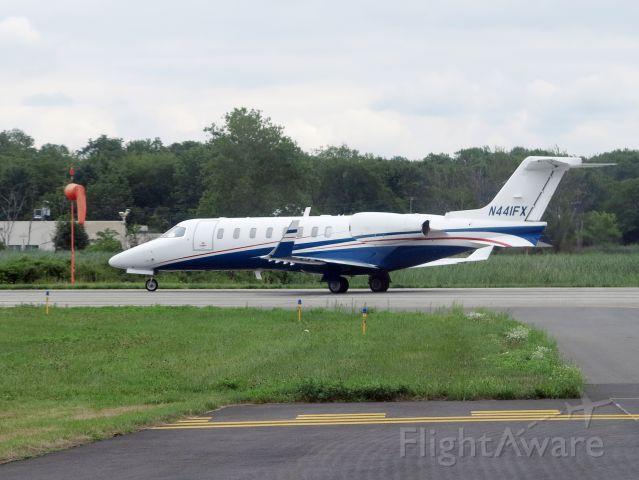 Learjet 45 (N441FX) - Holding short runway 05.