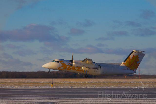 de Havilland Dash 8-100 (C-FACD) - Dash 8 heading for Toronto rotates off Runway 25 at Kingston