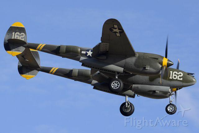 Lockheed P-38 Lightning (NX138AM) - Lockheed P-38J Lightning NX138AM 23 Skidoo at Luke AFB on March 13, 2014.