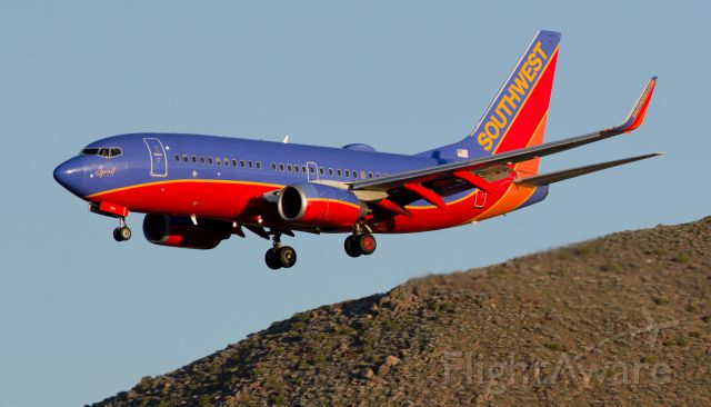 Boeing 737-700 (N793SA) - The setting sun is illuminating the western side of Rattlesnake Mountain and Southwest