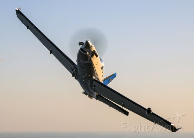 """Daher-Socata TBM-900 (N694PB) - Air to air photoflight with a privately owned TBM 900 over Lake Winnebago during Oshkosh AirVenture 2015. Photo taken by Michael Mainiero Photography <a rel=""""nofollow"""" href=""""http://www.MichaelMainieroPhoto.com"""">www.MichaelMainieroPhoto.com</a>"""