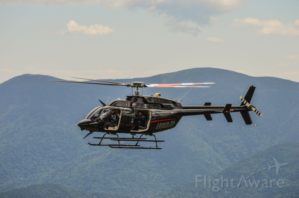 Bell 407 (N802JR) - Shot taken at the 2017 Climb to the Clouds Hillclimb that takes place up the Mt Washington Auto Road in the White Mountains of New Hampshire. br /The Bell in the shot is being used by the Subaru of America Factory Team to record footage for their web series, Launch Control.br /Shot with a Nikon D3200 w/ Nikkor 70-300mmbr /Best viewed in Full Size
