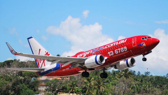 Boeing 737-700 (VH-VBD) - Sassy Sydney on take off RWY 32 Hamilton Island.  Aircraft is now with Aerolineas Argentinas as LV-CSI