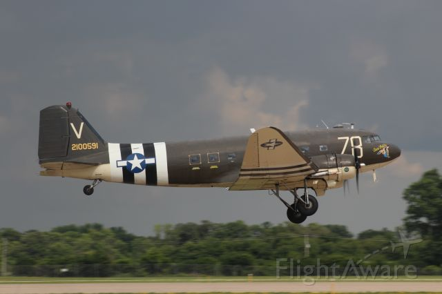 Douglas DC-3 (N3239T) - Tico Bell with Rain Clouds ahead of her.