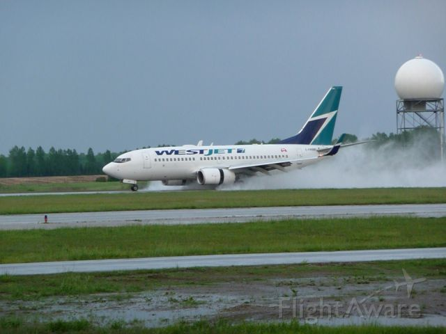 Boeing 737-700 (C-FWBW) - landing shortly after an early evening thunderstorm at CYXU/YXU