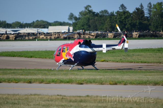 N133EH — - EAA 2011 Red Bull helicopter MBB BO-105 taking a rest after performing.